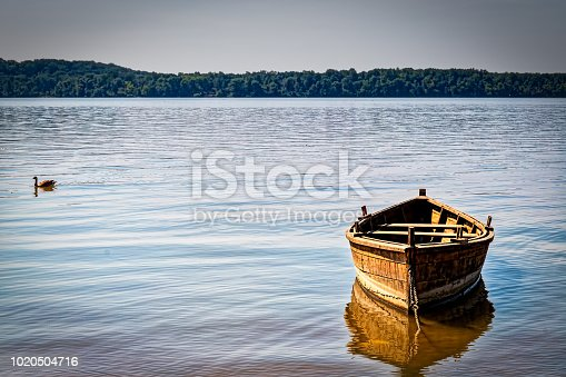 A small boat sits tide up to the shore of the Potomac River on the Virginia side.