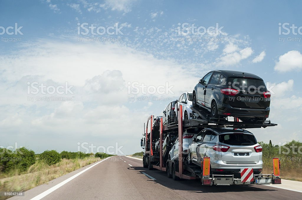 On the road carrying cars stock photo