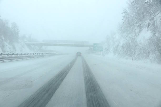 On the Road in a Blizzard Winter, Snow, Driving, Blizzard, Multiple Lane Highway blizzard stock pictures, royalty-free photos & images