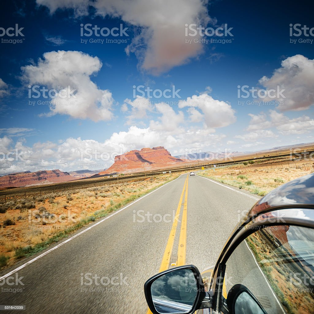 On the road in Monument valley National park desert stock photo