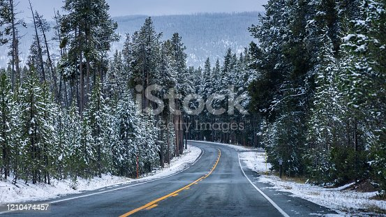 istock On the road of Yellowstone in winter season. 1210474457