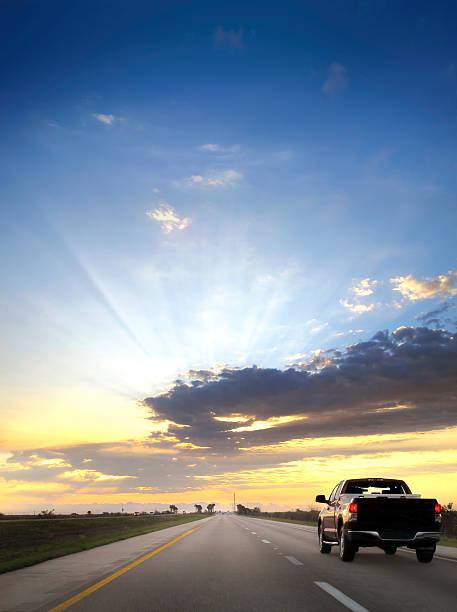 on the road over sunset - pikap stok fotoğraflar ve resimler