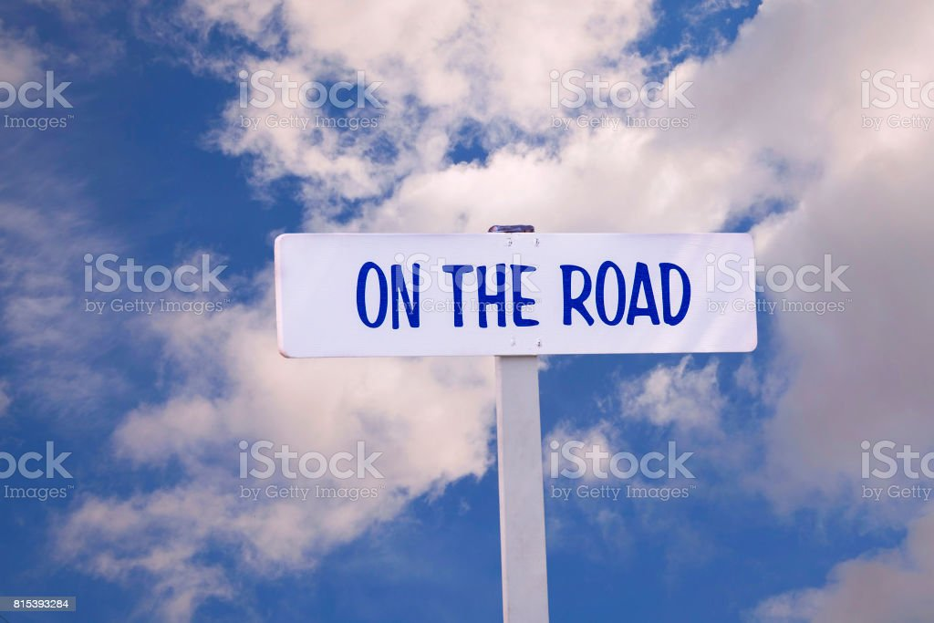 On the Road Sign with Sky in Background stock photo