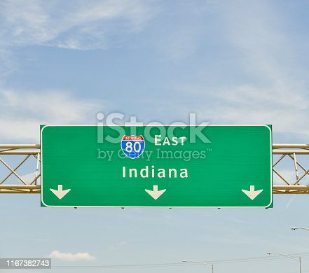 A green interstate sign points the way to Indiana.