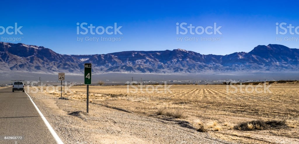on the road view of Nevada arid land in winter stock photo