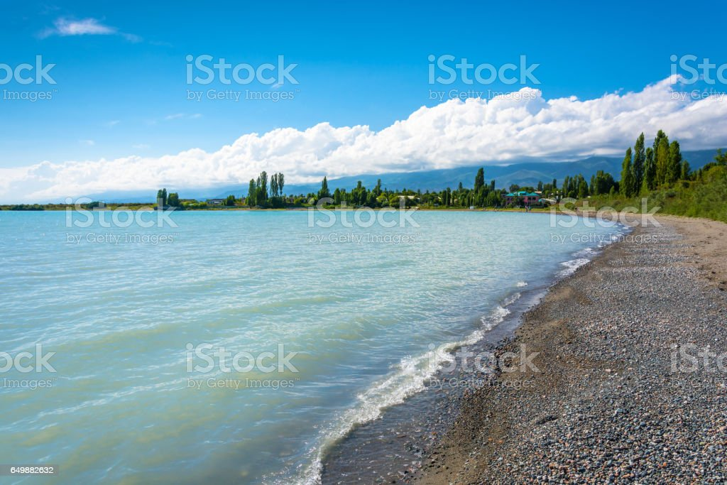 On the shore of lake Issyk-Kul, Kyrgyzstan. стоковое фото