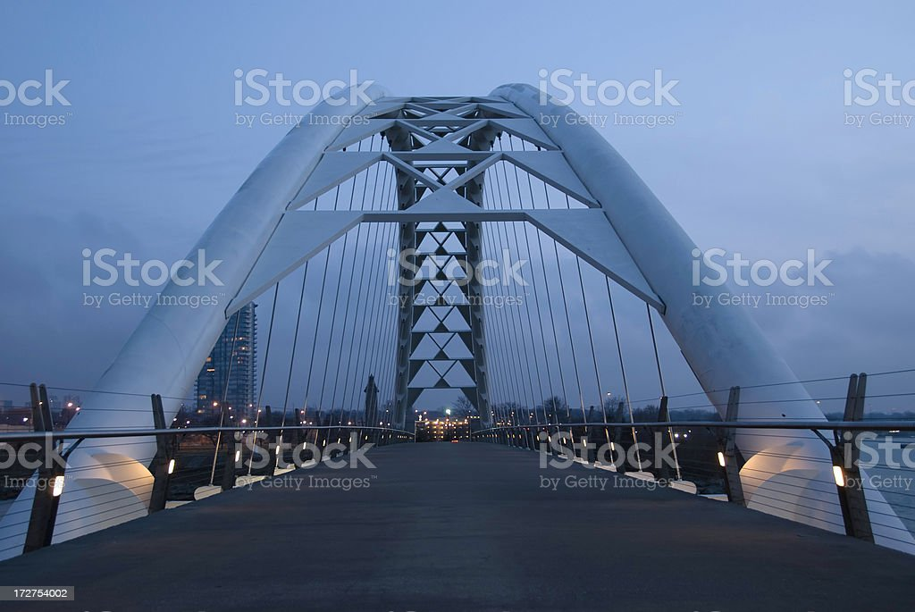 On the Suspension Bridge at Dawn stock photo