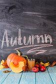 On the table are apples and pumpkins. Autumn still life. Autumn calendar.