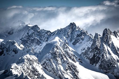 swiss alps mountain range in the clouds, titlis, switzerland.