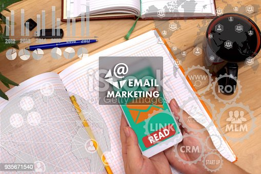 860524646istockphoto EMAIL MARKETING on the touch screen to the network, on office blur background. Concept of EMAIL MARKETING 935671540