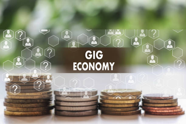 GIG ECONOMY on the touch screen with a  blur financial background .The concept GIG ECONOMY stock photo