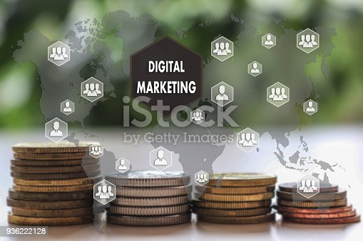 860524646istockphoto DIGITAL MARKETING  on the touch screen with a  blur financial background .The concept DIGITAL MARKETING 936222128
