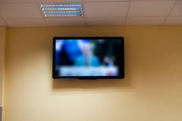 Télévision sur le mur - Photo
