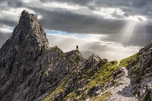 One Single Climber on the Ascent to the Summit