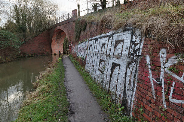 graffiti on  skew bridge wilts & berks canal - whiteway graffiti stock photos and pictures