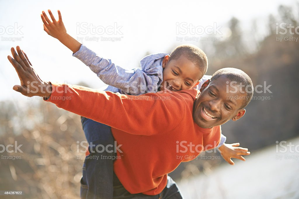 On the wings of fatherly love stock photo