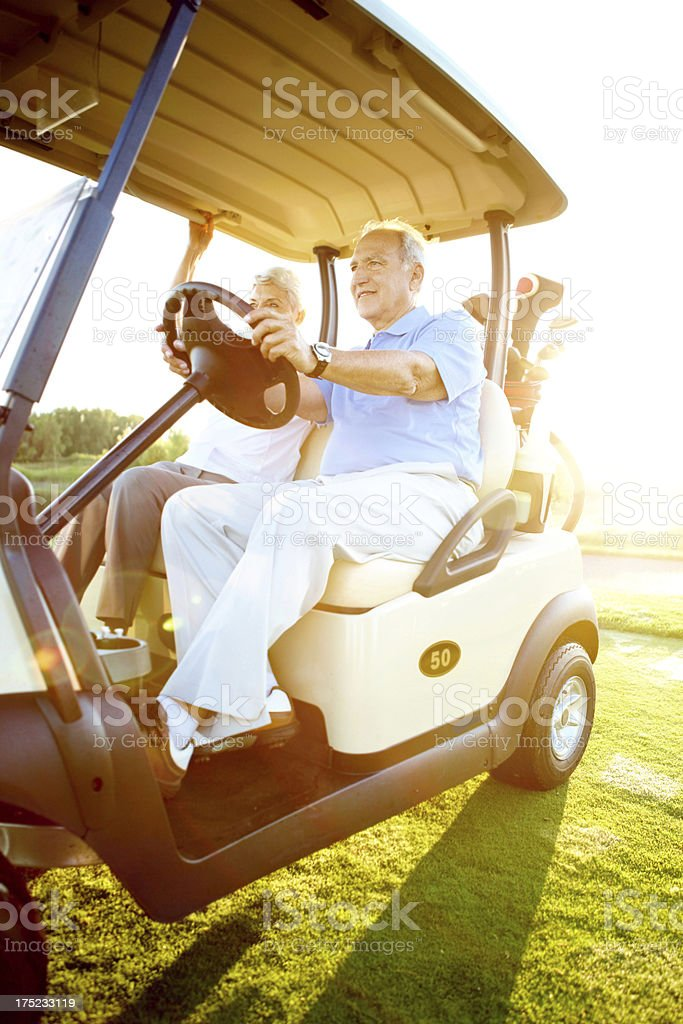 On their way to tee off royalty-free stock photo