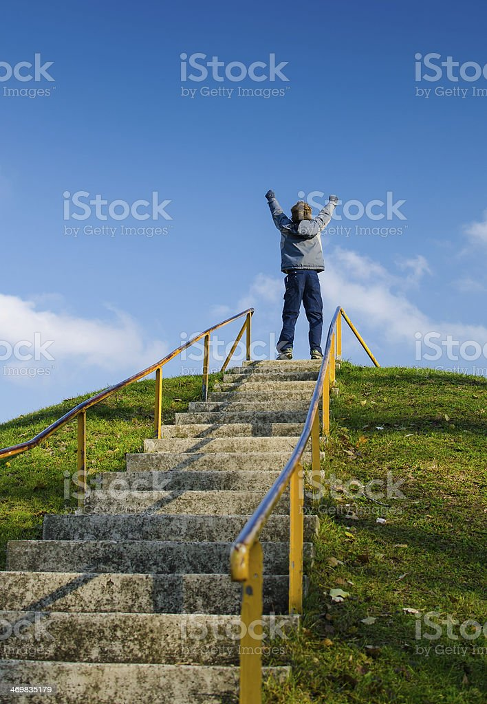 On Top Of High Outdoor Stairs And Celebrating stock photo