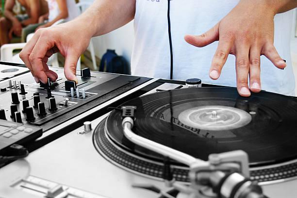 DJ on turntable stock photo