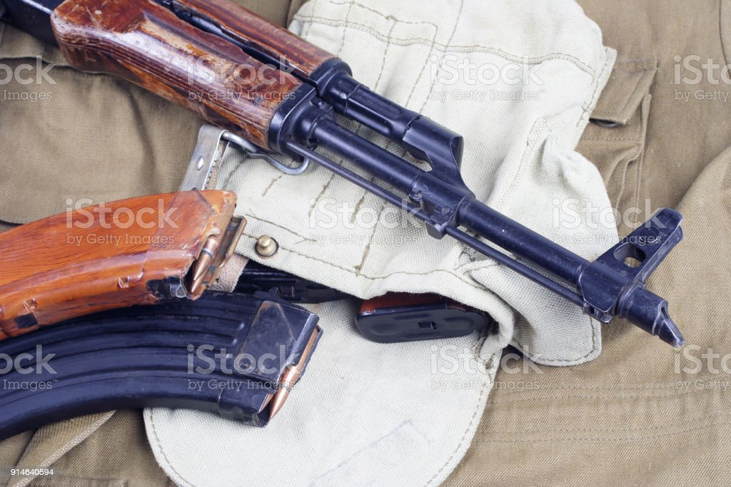 AK47 on USSR Soviet Army khaki uniform background stock photo