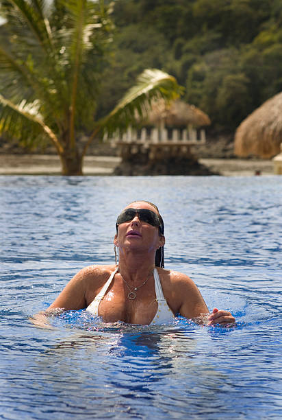 On Vacation Lady in the swimming pool middle aged women in bikinis stock pictures, royalty-free photos & images