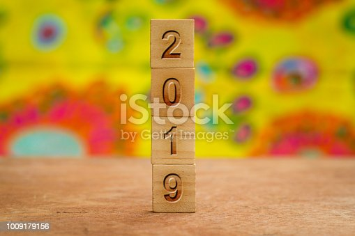 1009979852 istock photo 2019 on Wood cubes against colorful background 1009179156