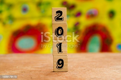 1009979852 istock photo 2019 on Wood cubes against colorful background 1009179170
