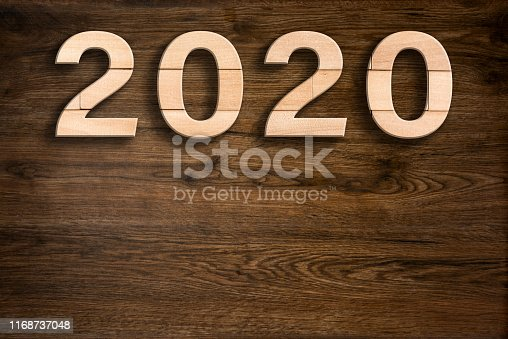 1018565666 istock photo 2020 on wooden background 1168737048