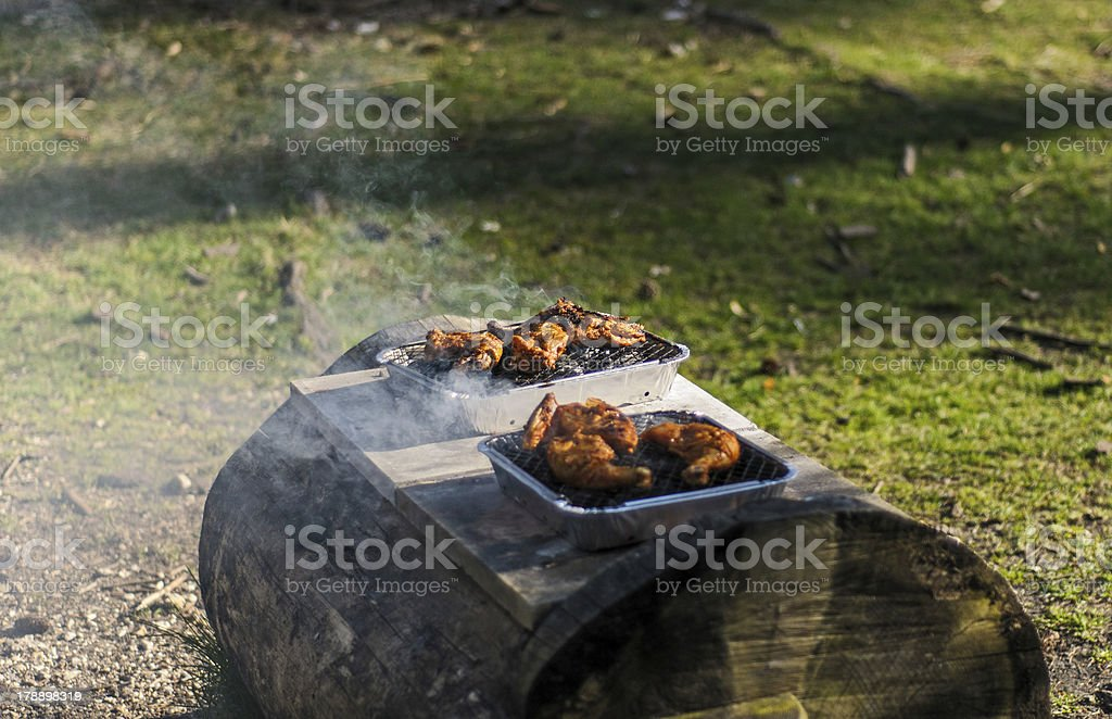 BBQ on wooden bench royalty-free stock photo