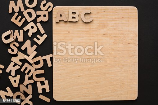 istock ABC on wooden board, copy space 843641280