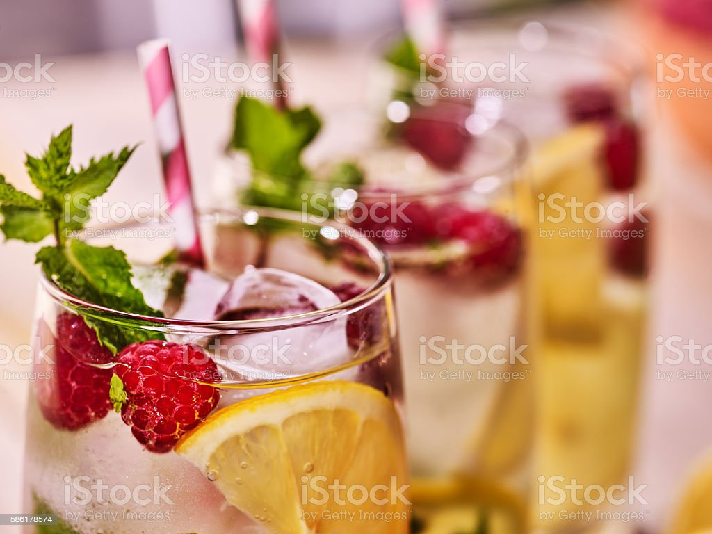 On wooden boards glasses with raspberry mohito and lime. stock photo