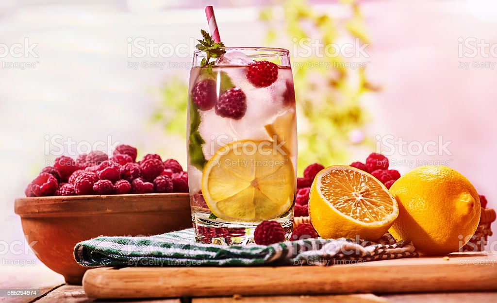 On wooden boards is glass with mohito and lime. stock photo