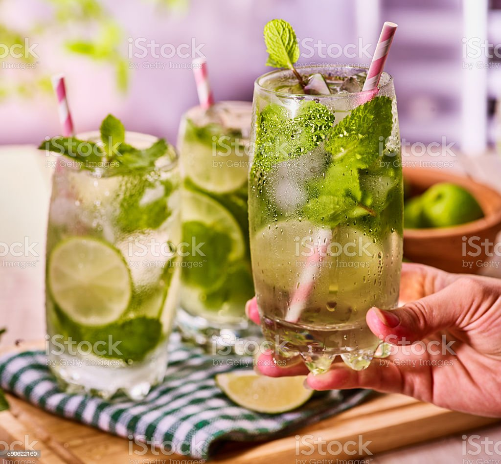 On wooden boards is glasses with mohito and lime. stock photo