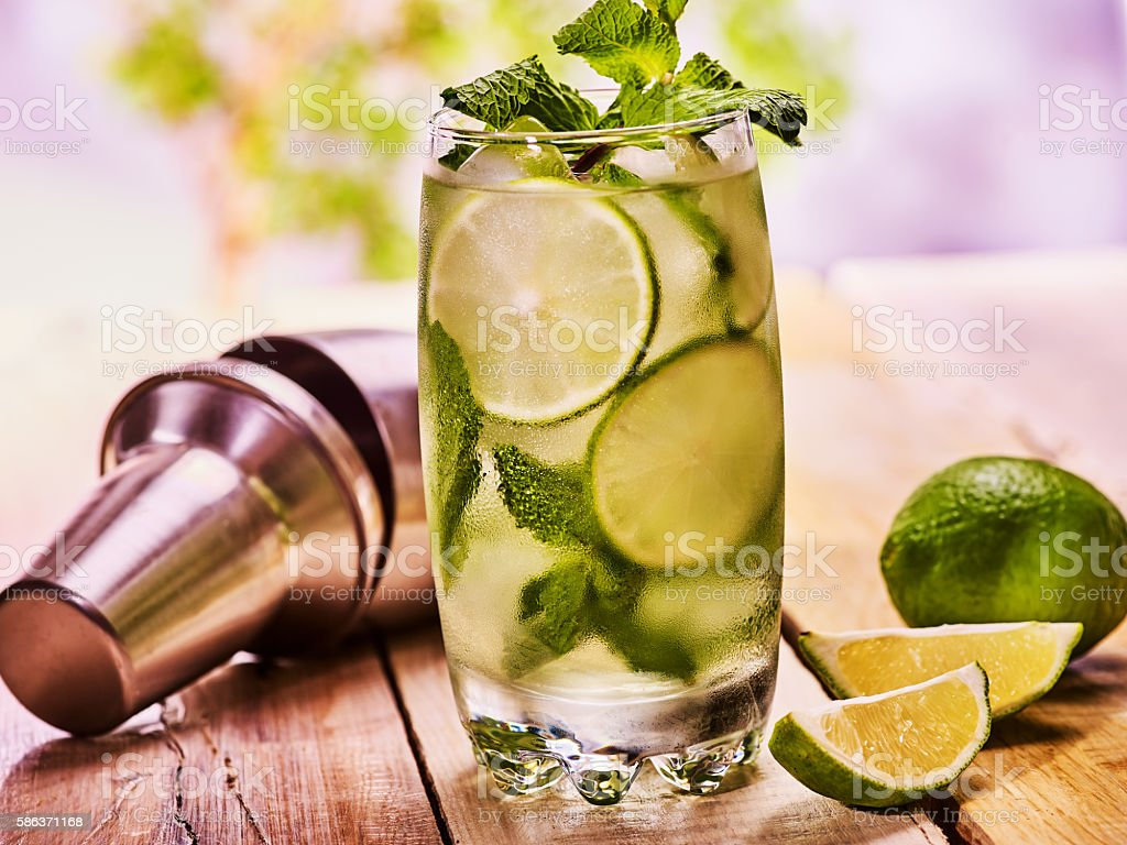 On wooden boards is glasses with mohito. stock photo
