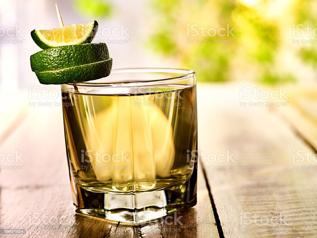 On wooden boards is mohito drink glass and half lime. stock photo