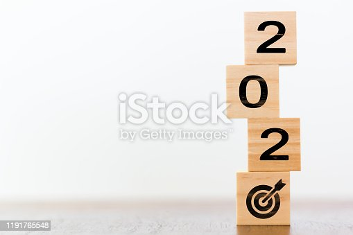 168589045 istock photo 2020 on wooden cubes with goal target. New year´s sucess concept 1191765548