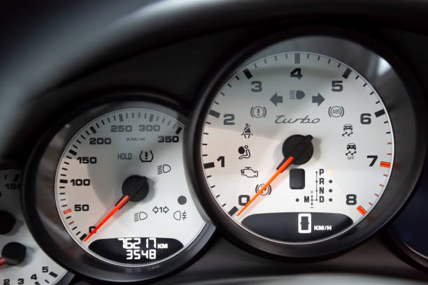 On-board computer and white dashboard Porsche Panamera Turbo. Tachometer, speedometer, oil level. Red arrows on the dashboard. Luxury German Sedan stock photo
