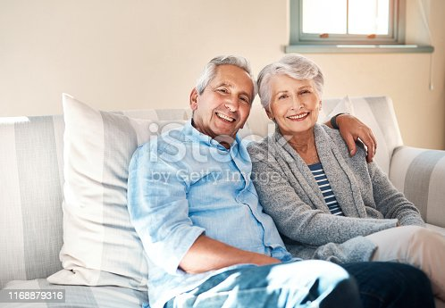 Shot of a senior couple relaxing together on the sofa at home