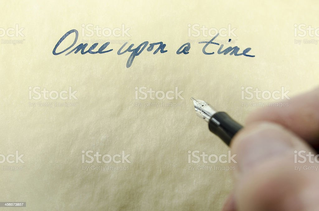 Once upon a time written in cursive on parchment stock photo