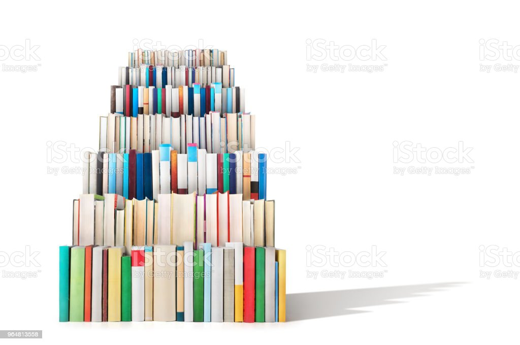 oncept of education. Stack of books in the form of a ladder isolated on white background. oncept of learning. Achievement. royalty-free stock photo