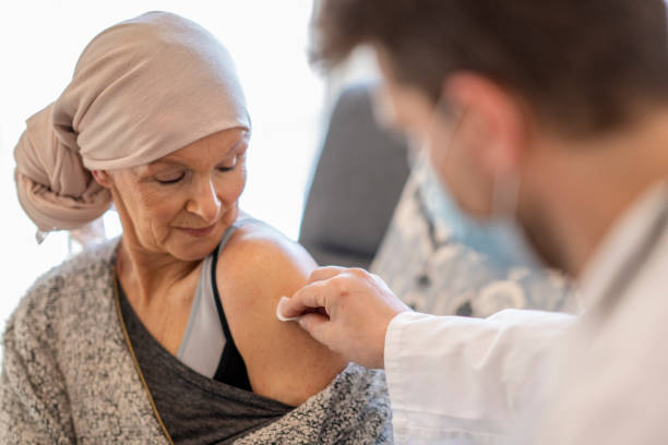Oncology patient receives vaccination stock photo
