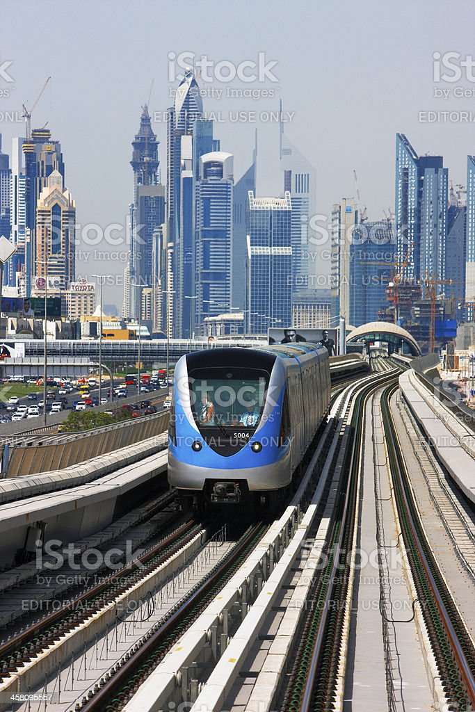 Oncoming blue car of a Dubai metro stock photo