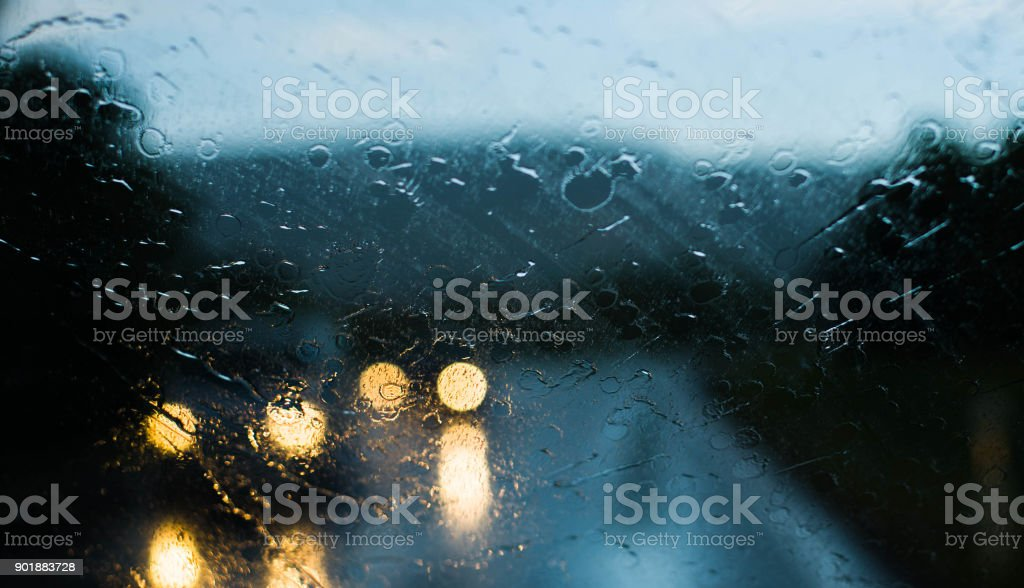 Oncoming Cars in the Rain - View through the Front Window of Car - on the Road stock photo