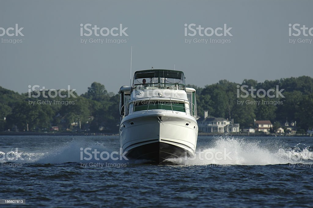 oncoming luxury powerboat stock photo