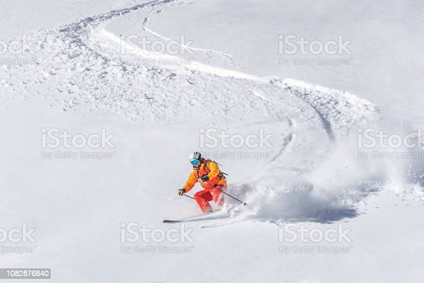 One adult freeride skier skiing downhill through deep powder snow picture id1082876840?b=1&k=6&m=1082876840&s=612x612&h=pugdfq4hbg8qumtu8trg5ymm1oqsl5ozvjn28tze9oi=