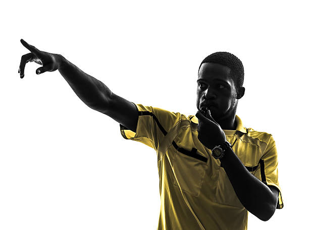 one african man referee whistling pointing silhouette one african man referee whistling pointing in silhouette on white background referee stock pictures, royalty-free photos & images