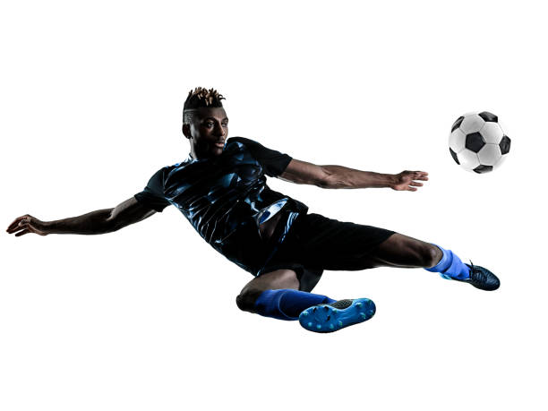 one african soccer player man isolated white background silhouet - soccer player stock photos and pictures