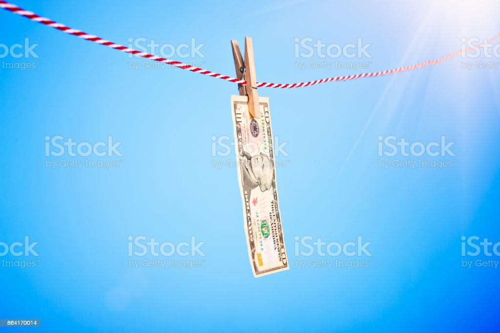 One American banknote hung out to dry royalty-free stock photo