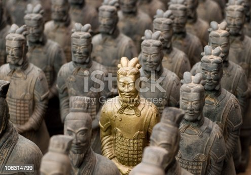 One gold painted replica Terracotta Warrior among many unpainted examples near Xian in Shaanxi province, China.    [url=file_closeup.php?id=4604624][img]file_thumbview_approve.php?size=2&id=4604624[/img][/url]  [url=file_closeup.php?id=4484726][img]file_thumbview_approve.php?size=2&id=4484726[/img][/url]  [url=file_closeup.php?id=4597176][img]file_thumbview_approve.php?size=2&id=4597176[/img][/url]  [url=file_closeup.php?id=4484566][img]file_thumbview_approve.php?size=2&id=4484566[/img][/url]  [url=file_closeup.php?id=5007974][img]file_thumbview_approve.php?size=2&id=5007974[/img][/url]  [url=file_closeup.php?id=11490886][img]file_thumbview_approve.php?size=2&id=11490886[/img][/url]