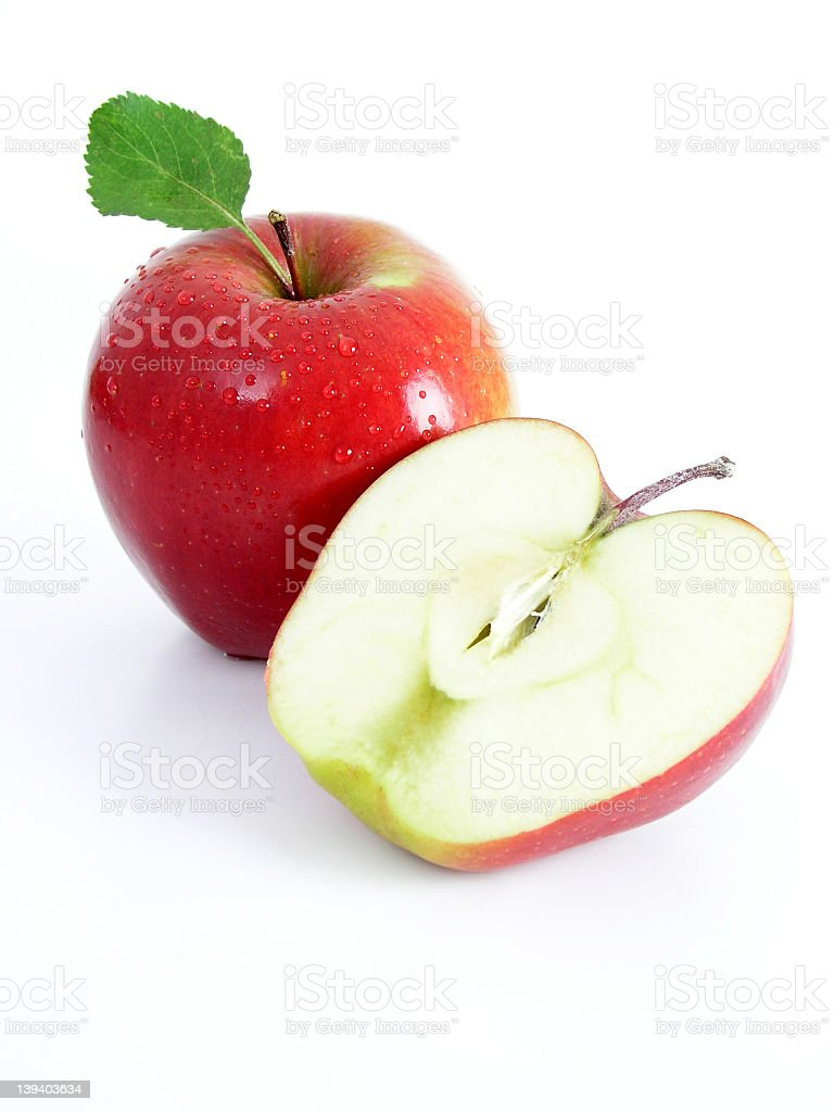 One and a half red apples on a white background royalty-free stock photo